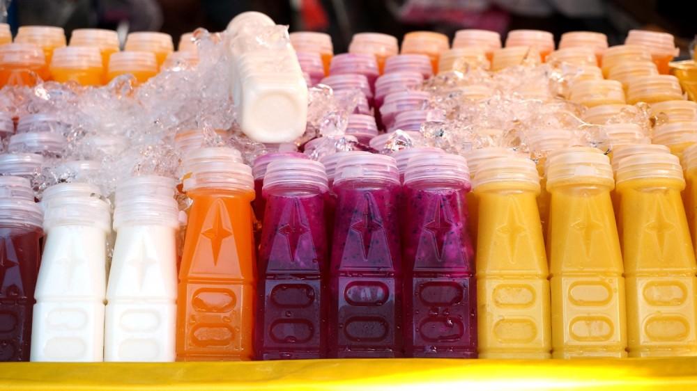 Freshly bottled juice at Tha Chang food market